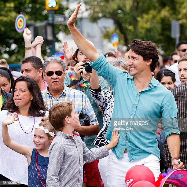 Ella-Grace Margaret Trudeau waves to the crowd while Xavier James Trudeau touches Prime Minister of Canada Justin Trudeau belly during the 38th...