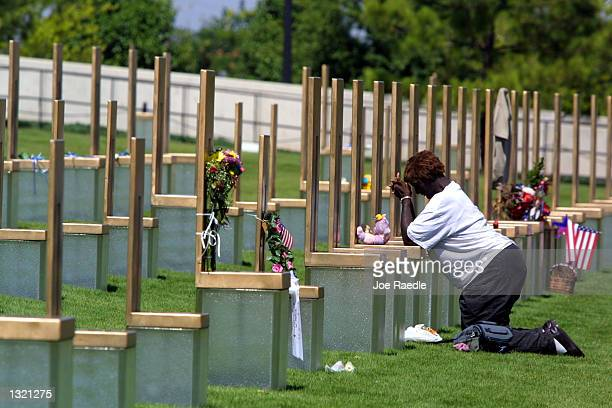 Ellajean Thompson mourns at the chair that represents her aunt Laura Jane Garrison June 11 2001 at the Oklahoma National Memorial in Oklahoma City...