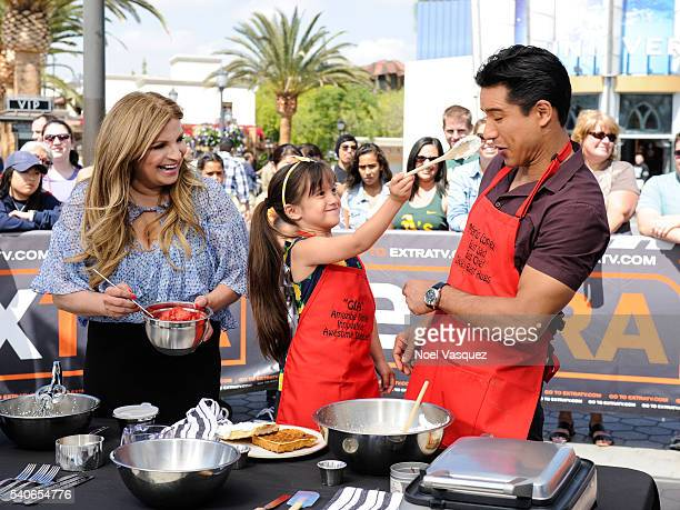 "Ellamarie Fortenbach, Gia Francesca Lopez and Mario Lopez make waffles at ""Extra"" at Universal Studios Hollywood on June 15, 2016 in Universal City,..."