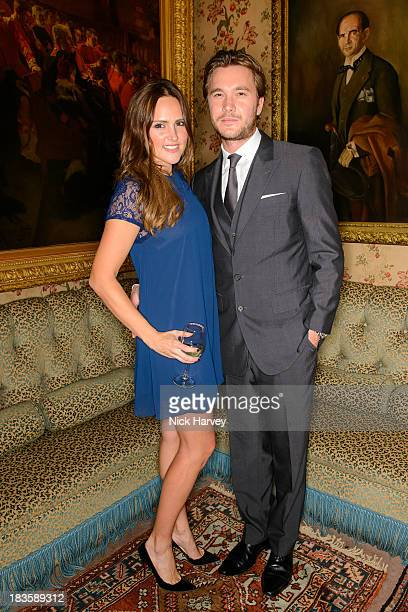 Elle Caring and Ben Caring attend Nicola and James Stephenson Tracey Emin and Johnny Bergius VIP Party at Mark's Club on October 7 2013 in London...