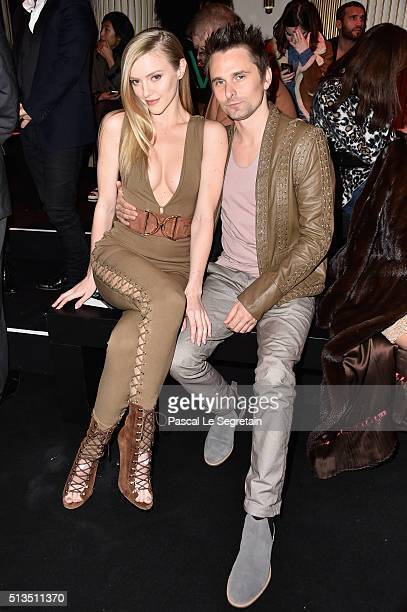 Elle Evans and Matt Bellamy attend the Balmain show as part of the Paris Fashion Week Womenswear Fall/Winter 2016/2017 on March 3 2016 in Paris France