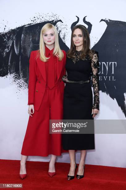 """Elle Fanning and Angelina Jolie attend a photocall for """"Maleficent: Mistress of Evil"""" at Mandarin Oriental Hotel on October 10, 2019 in London,..."""
