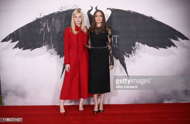 "Elle Fanning and Angelina Jolie attend a photocall for ""Maleficent: Mistress of Evil"" at Mandarin Oriental Hotel on October 10, 2019 in London,..."