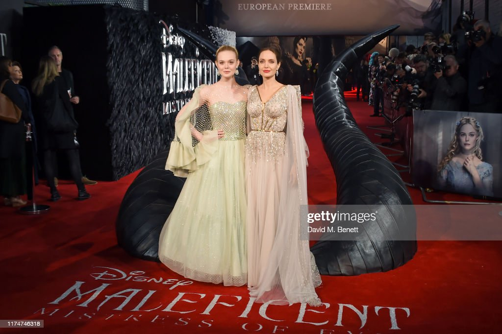 Elle Fanning And Angelina Jolie Attend The European Premiere