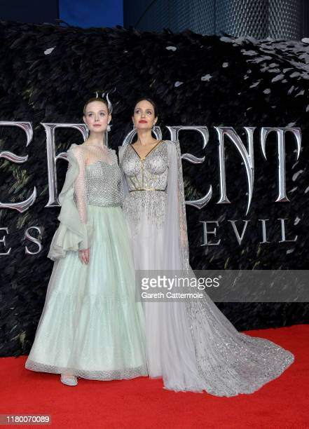 """Elle Fanning and Angelina Jolie attend the European Premiere of Disney's """"Maleficent: Mistress of Evil"""" at Odeon IMAX Waterloo on October 09, 2019 in..."""