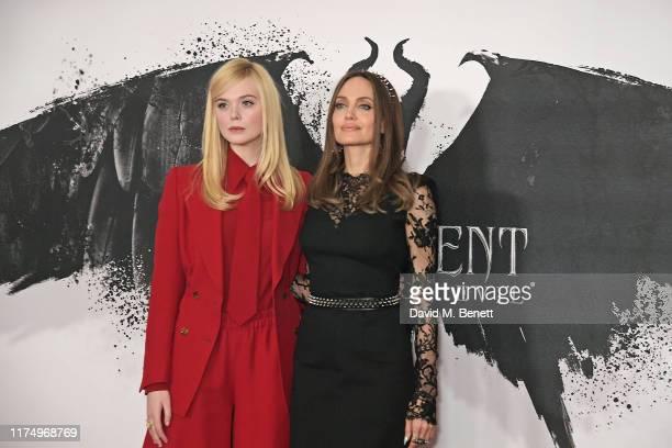 "Elle Fanning and Angelina Jolie attend the ""Maleficent: Mistress Of Evil"" photocall at the Mandarin Oriental Hotel on October 10, 2019 in London,..."