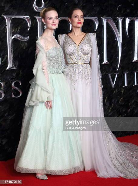 Elle Fanning and Angelina Jolie attend the Maleficent Mistress of Evil European Film Premiere at the Odeon IMAX Waterloo in London