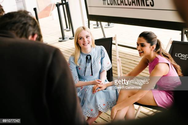 Elle Fanning and Deepika Padukone are photographed at the L'Oreal Paris Beach Studio during the 70th annual Cannes Film Festival on May 18 2017 in...