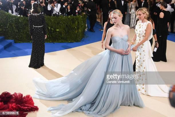 Elle Fanning and Diane Kruger attend 'Rei Kawakubo/Comme des Garcons Art Of The InBetween' Costume Institute Gala Arrivals at Metropolitan Museum of...