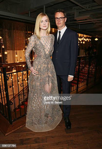 """Elle Fanning and director Nicolas Winding Refn attend the UK Premiere of """"The Neon Demon"""" at Picturehouse Central on May 31, 2016 in London, England."""