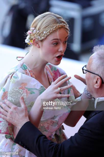 Elle Fanning and General Delegate Thierry Fremaux attend the screening of Les Miserables during the 72nd annual Cannes Film Festival on May 15 2019...