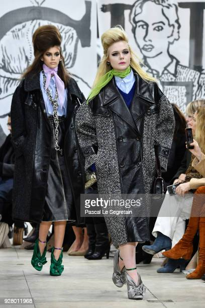 Elle Fanning and Kaia Gerber walk the runway during the Miu Miu show as part of the Paris Fashion Week Womenswear Fall/Winter 2018/2019 on March 6...