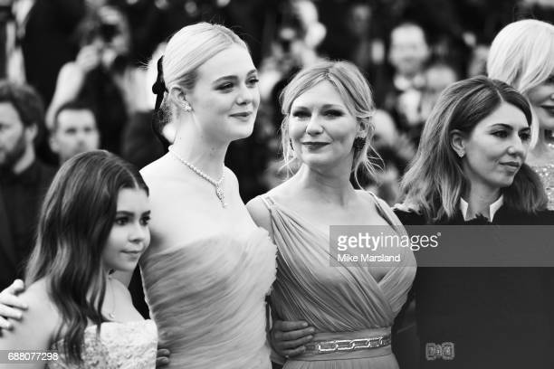 Elle Fanning and Kirsten Dunst attend the 'The Beguiled' screening during the 70th annual Cannes Film Festival at Palais des Festivals on May 24 2017...