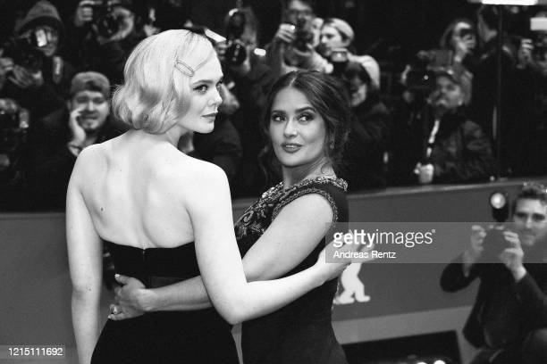"Elle Fanning and Salma Hayek pose at the ""The Roads Not Taken"" premiere during the 70th Berlinale International Film Festival Berlin at Berlinale..."