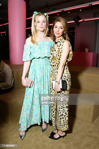 Elle Fanning and Sofia Coppola attend the Prada Resort 2020 fashion show at Prada Headquarters on May 02 2019 in New York City