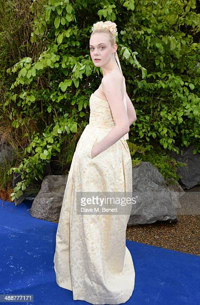 """Elle Fanning arrives at a private reception as costumes and props from Disney's """"Maleficent"""" are exhibited in support of Great Ormond Street Hospital..."""