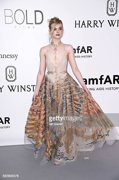 Elle Fanning arrives at amfAR's 23rd Cinema Against AIDS Gala at Hotel du CapEdenRoc on May 19 2016 in Cap d'Antibes France