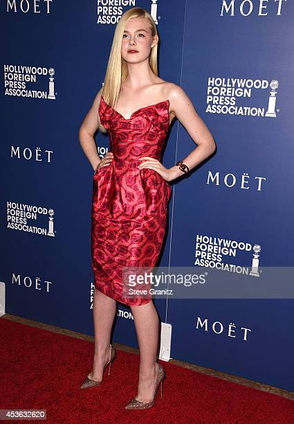Elle Fanning arrives at the The Hollywood Foreign Press Association Installation Dinner at The Beverly Hilton Hotel on August 14 2014 in Beverly...
