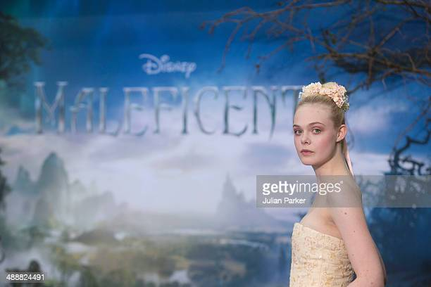 """Elle Fanning attends a private reception as costumes and props from Disney's """"Maleficent"""" are exhibited in support of Great Ormond Street Hospital at..."""