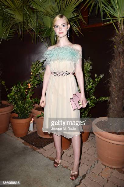 Elle Fanning attends Fondazione Prada Private Dinner during the 70th annual Cannes Film Festival at Restaurant Fred L'Ecailler on May 22 2017 in...