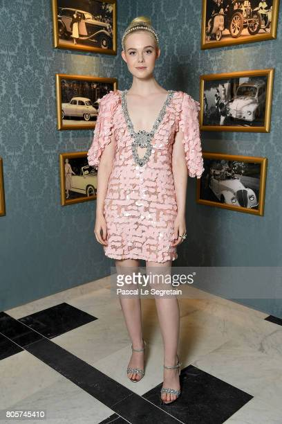 Elle Fanning attends Miu Miu Cruise Collection show as part of Haute Couture Paris Fashion Week on July 2 2017 in Paris France