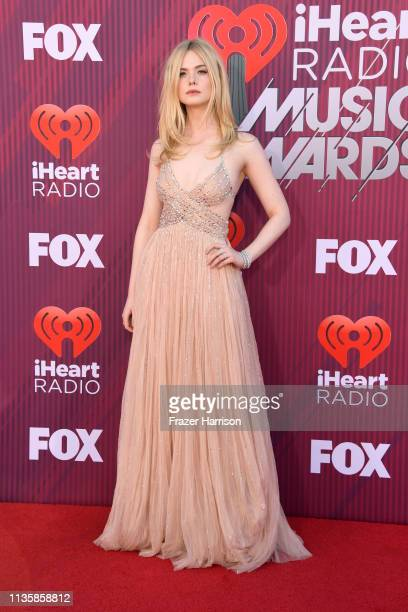 Elle Fanning attends the 2019 iHeartRadio Music Awards which broadcasted live on FOX at Microsoft Theater on March 14 2019 in Los Angeles California