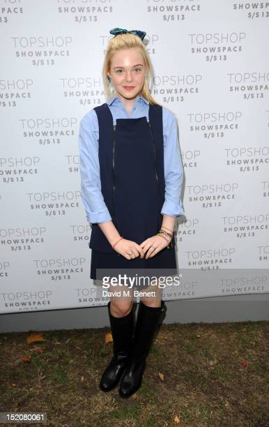 Elle Fanning attends the front row for the Unique show on day 3 of London Fashion Week Spring/Summer 2013 at TopShop Venue on September 16 2012 in...