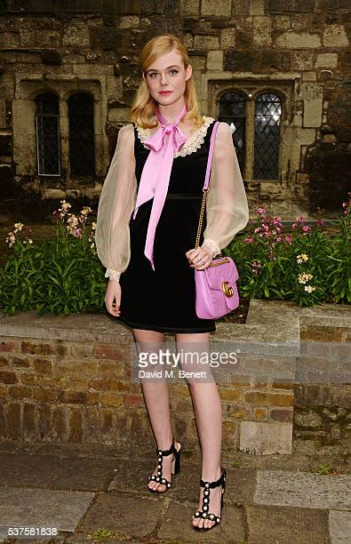 Elle Fanning attends the Gucci Cruise 2017 fashion show at the Cloisters of Westminster Abbey on June 2 2016 in London England