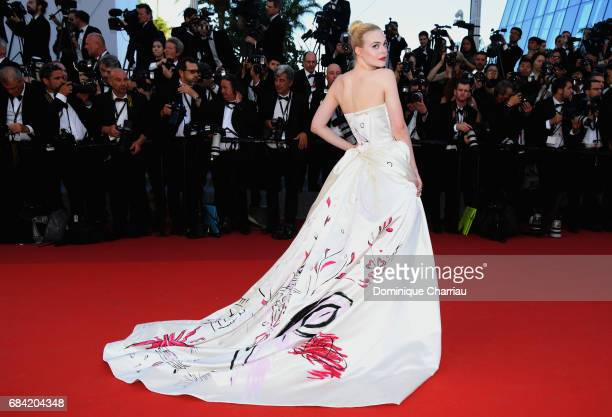 Elle Fanning attends the Ismael's Ghosts screening and Opening Gala during the 70th annual Cannes Film Festival at Palais des Festivals on May 17...