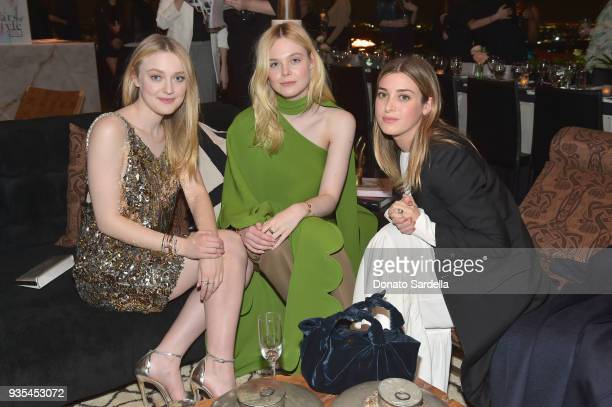 Elle Fanning Dakota Fanning and Jamie Mizrahi attend The Hollywood Reporter and Jimmy Choo Power Stylists Dinner on March 20 2018 in Los Angeles...