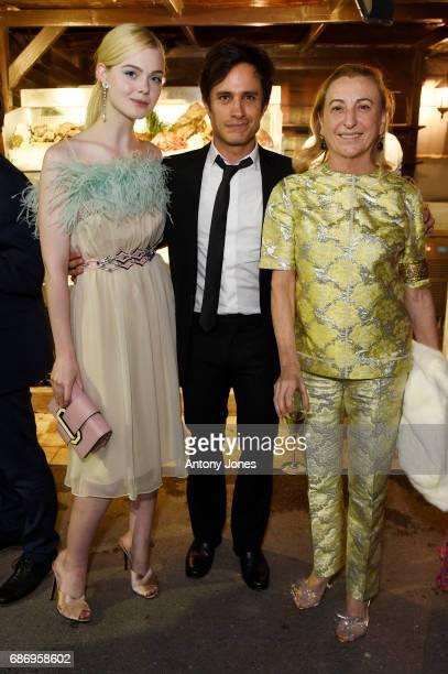 Elle Fanning Gael Garcia Bernal and Miuccia Prada attend Fondazione Prada Private Dinner during the 70th annual Cannes Film Festival at Restaurant...