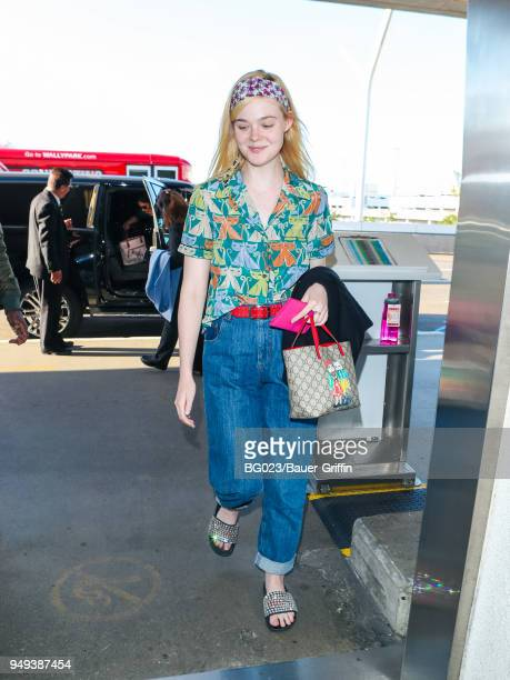 Elle Fanning is seen at Los Angeles International Airport on April 20 2018 in Los Angeles California