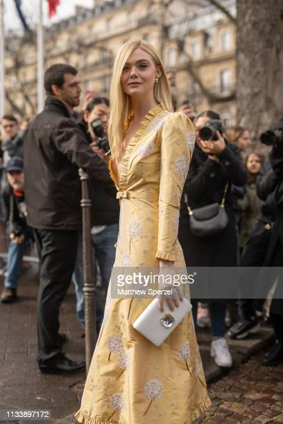 Elle Fanning is seen on the street attending MIU MIU during Paris Fashion Week AW19 wearing MIU MIU dress on March 05 2019 in Paris France
