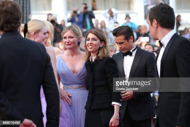 Elle Fanning, Kirsten Dunst cries, Sofia Coppola and Colin Farrell attend the 'The Beguiled' screening during the 70th annual Cannes Film Festival at...