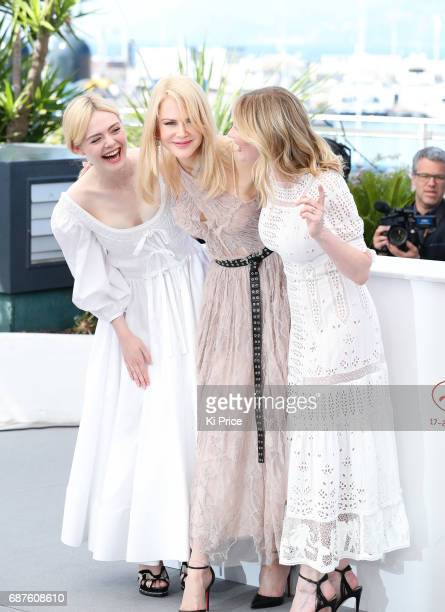 Elle Fanning Nicole Kidman and Kirsten Dunst attend the The Beguiled photocall during the 70th annual Cannes Film Festival at Palais des Festivals on...