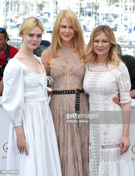 Elle Fanning Nicole Kidman and Kirsten Dunst attend the 'The Beguiled' Photocall during the 70th annual Cannes Film Festival at Palais des Festivals...