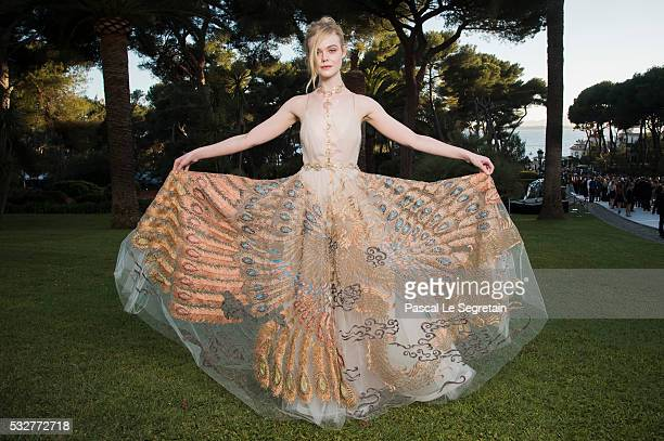 Elle Fanning poses for photographs at the amfAR's 23rd Cinema Against AIDS Gala at Hotel du CapEdenRoc on May 19 2016 in Cap d'Antibes France