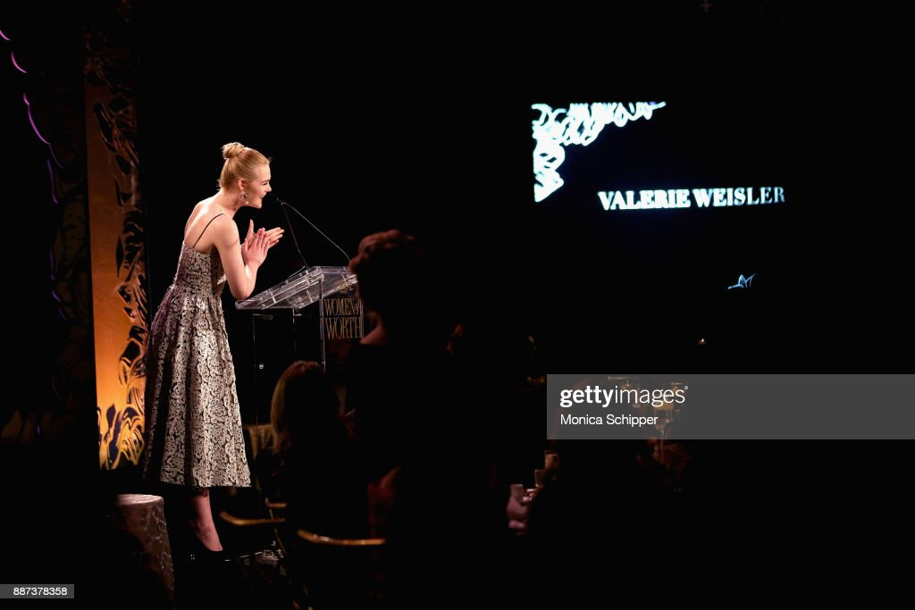 Elle Fanning speaks onstage during the L'Oreal Paris Women of Worth Celebration 2017 on December 6, 2017 in New York City.