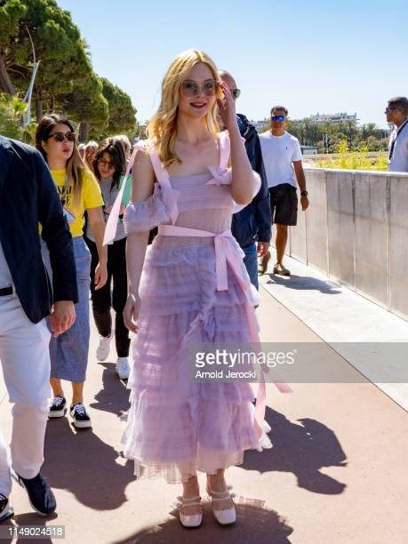 Elle Fanning walks on the Croisette during the 72nd annual Cannes Film Festival on May 14 2019 in Cannes France