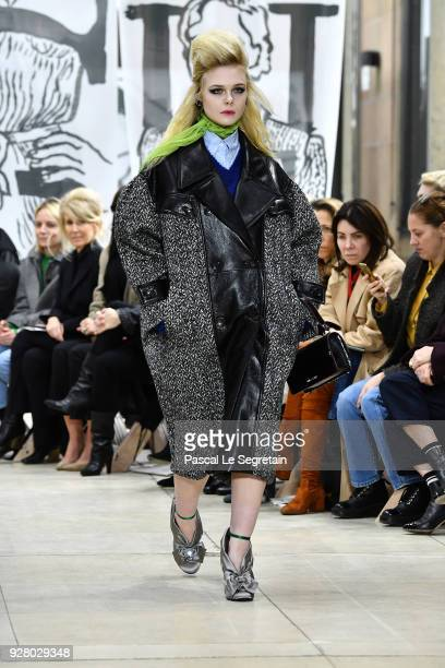 Elle Fanning walks the runway during the Miu Miu show as part of the Paris Fashion Week Womenswear Fall/Winter 2018/2019 on March 6 2018 in Paris...