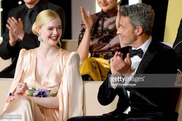 Elle Fanning wearing Chopard jewels and Pawel Pawlikowski attend the Opening Ceremony during the 72nd annual Cannes Film Festival on May 14 2019 in...