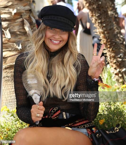 Elle Ferguson at the REVOLVE Desert House during Coachella on April 16 2017 in Palm Springs California on April 16 2017 in Palm Springs California