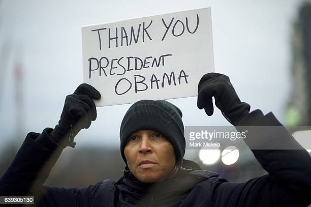 Elle Johnson holds a placard thanking President Barack Obama near the National Mall before the inauguration of Donald Trump as the 45th President of...