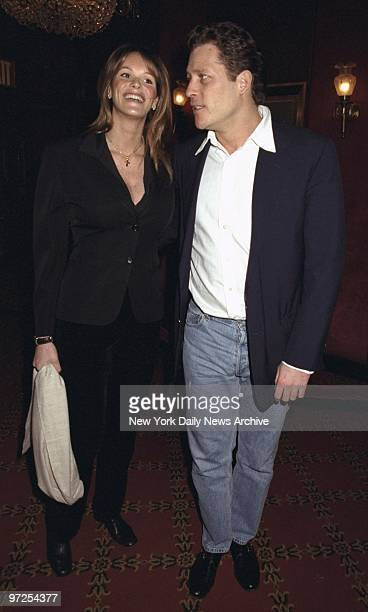 Elle MacPherson and boyfriend arrive for premiere of the movie 'The Man in the Iron Mask' at the Ziegfeld Theater