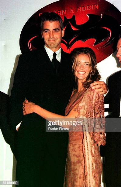 Elle Macpherson and George Clooney at the movie premiere of 'Batman and Robin'. .