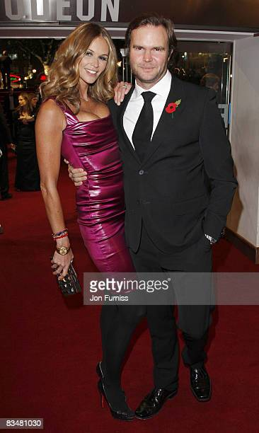 Elle Macpherson and guest attend the world premiere of 'Quantum of Solace' at Odeon Leicester Square on October 29, 2008 in London, England.