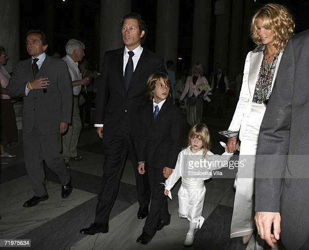 Elle Macpherson arrives with her partner Arpad Busson and their sons Flynn and Aurelius for the christening of Aurelius at Basillica Santa Maria...