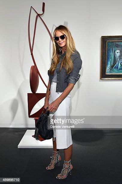 Elle Macpherson attends Art Basel Miami Beach 2014 VIP Preview at the Miami Beach Convention Center on December 3 2014 in Miami Beach Florida