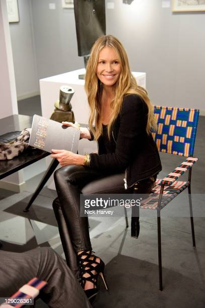 Elle Macpherson attends the private view of The Pavilion of Art and Design London 2011 at Berkeley Square Gardens on October 10 2011 in London England