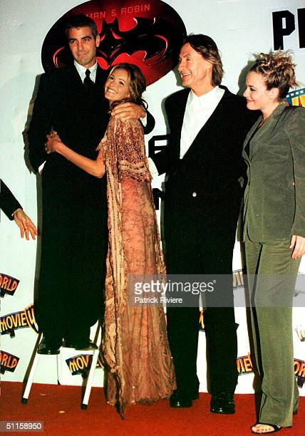 Elle Macpherson, George Clooney, Joel Schumacher and Alicia Silverstone at the movie premiere of 'Batman and Robin'. .